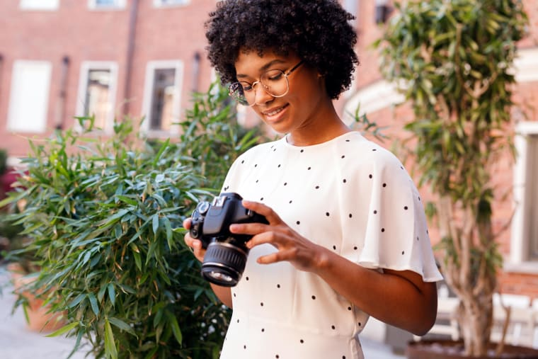 Girl looking at her camera