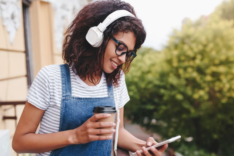 Girl drinking coffee while listening to music