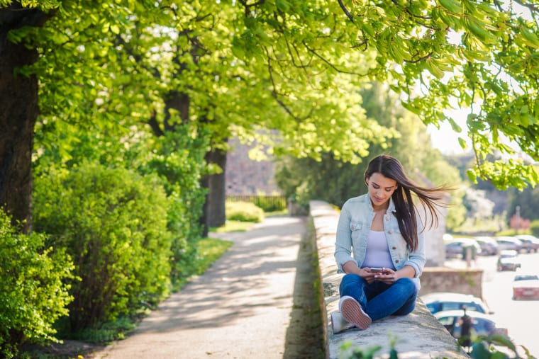Girl sitting in nature pathway