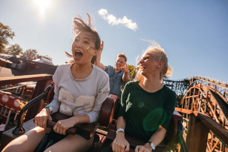Photo of friends on a roller coaster