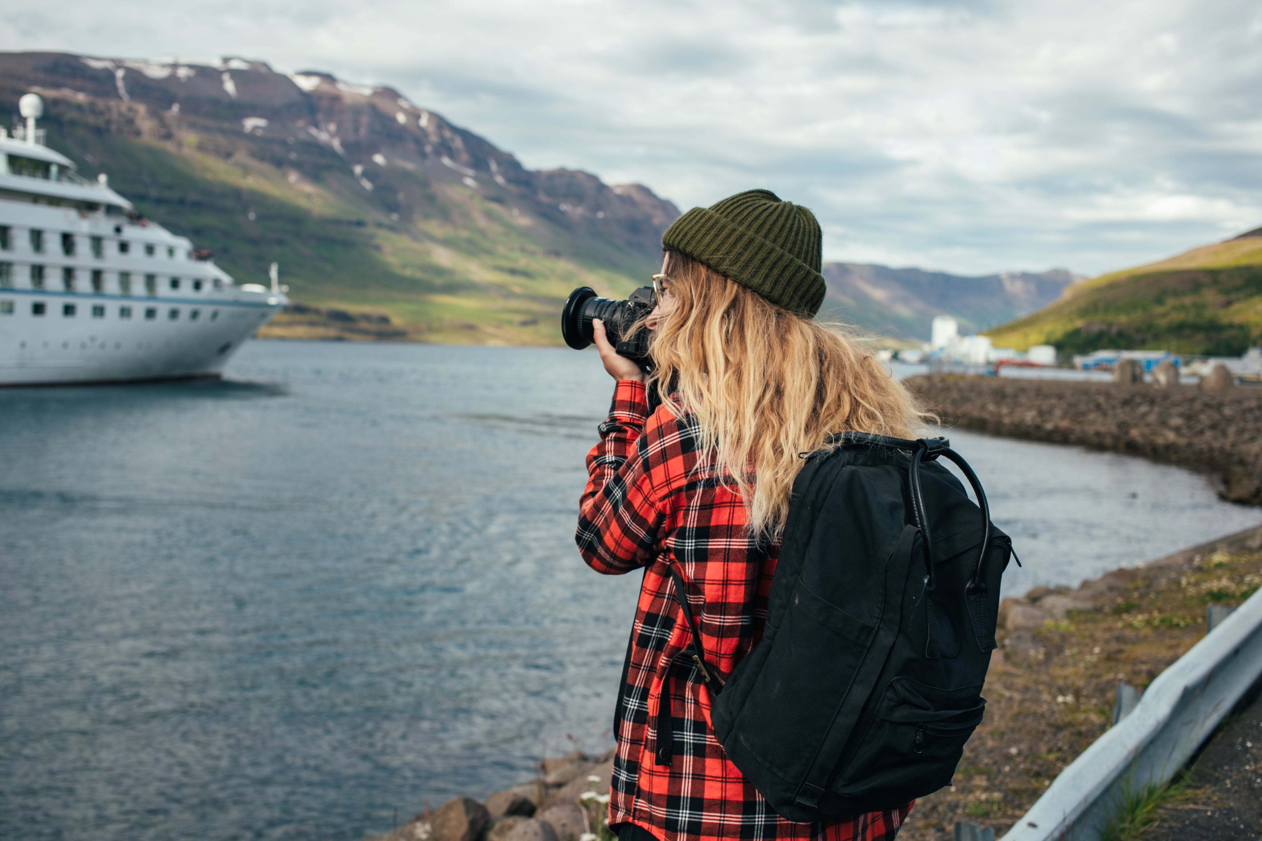Girl taking a photo of a boat