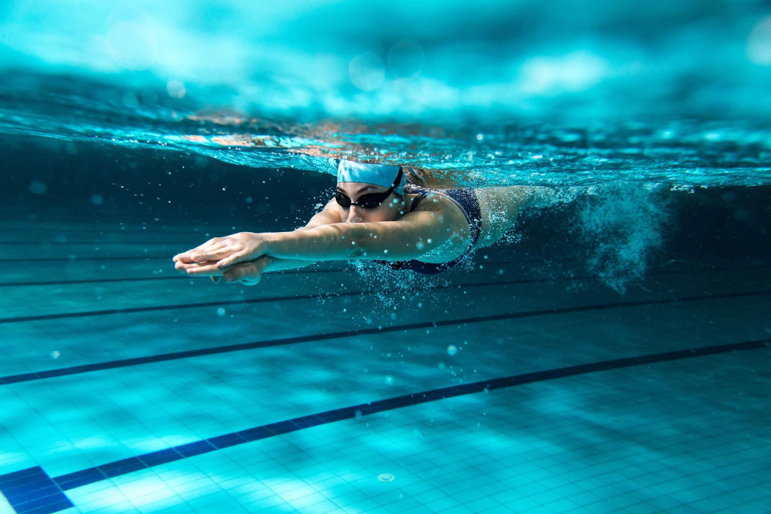 Underwater photo of a girl swimming