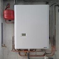 Pose de la chaudière Hydroconfort Condensation dans une maison