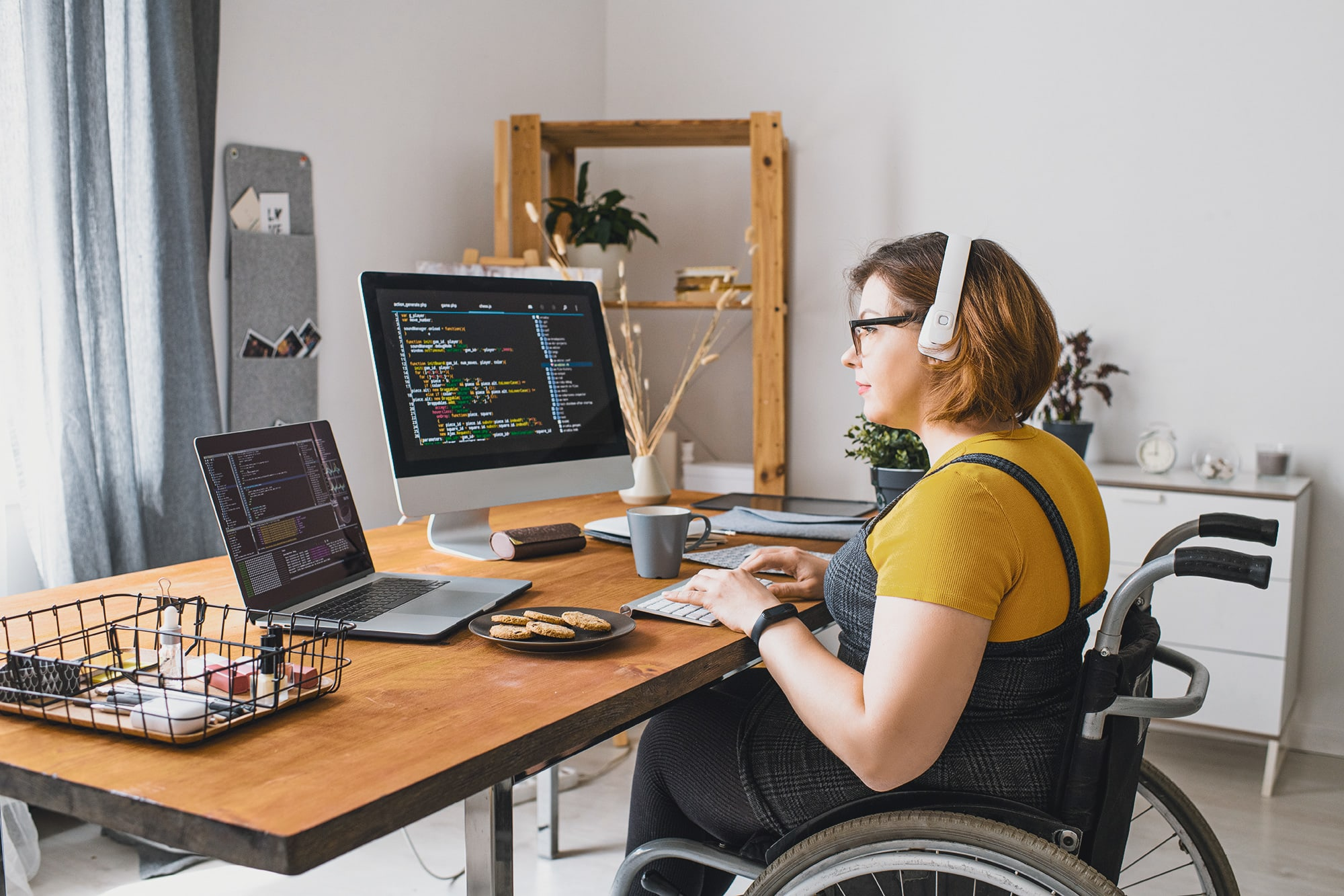 Wheelchair woman working remotely at home