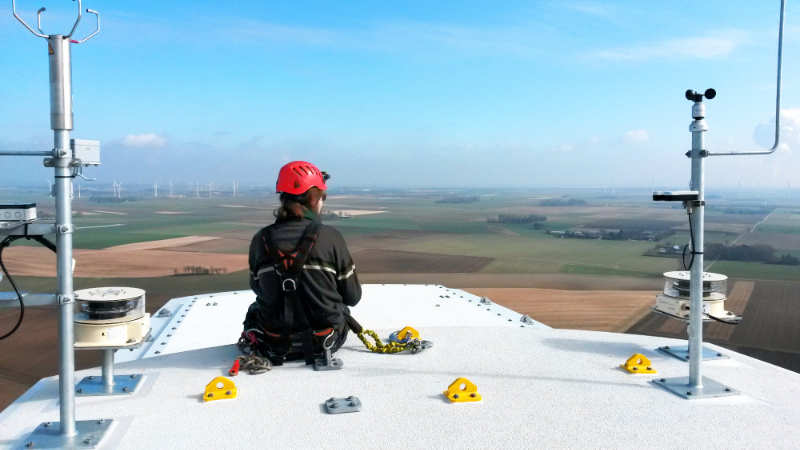 fos4X employee enjoys the view from the roof of a wind turbine