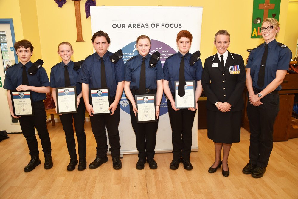 Volunteer police cadets (Luke Quinton, Sophie Keller, Oliver Blackwell,  Katie Lewis, Aidan Atkins) with Chief Constable Olivia Pinkney and cadet leader Laura Jones.