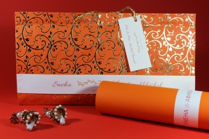Prevailing orange shine invite wedding card