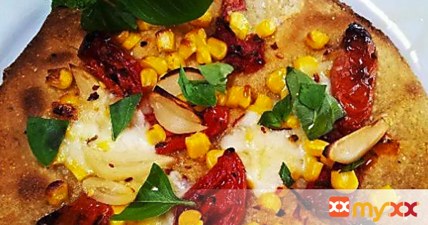 Fresh Corn, Roasted Tomato & Pickled Garlic Pizza with Cornmeal Crust