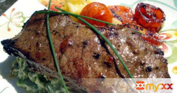 Striploin steak with roasted cherry tomatoes and vegetable mash