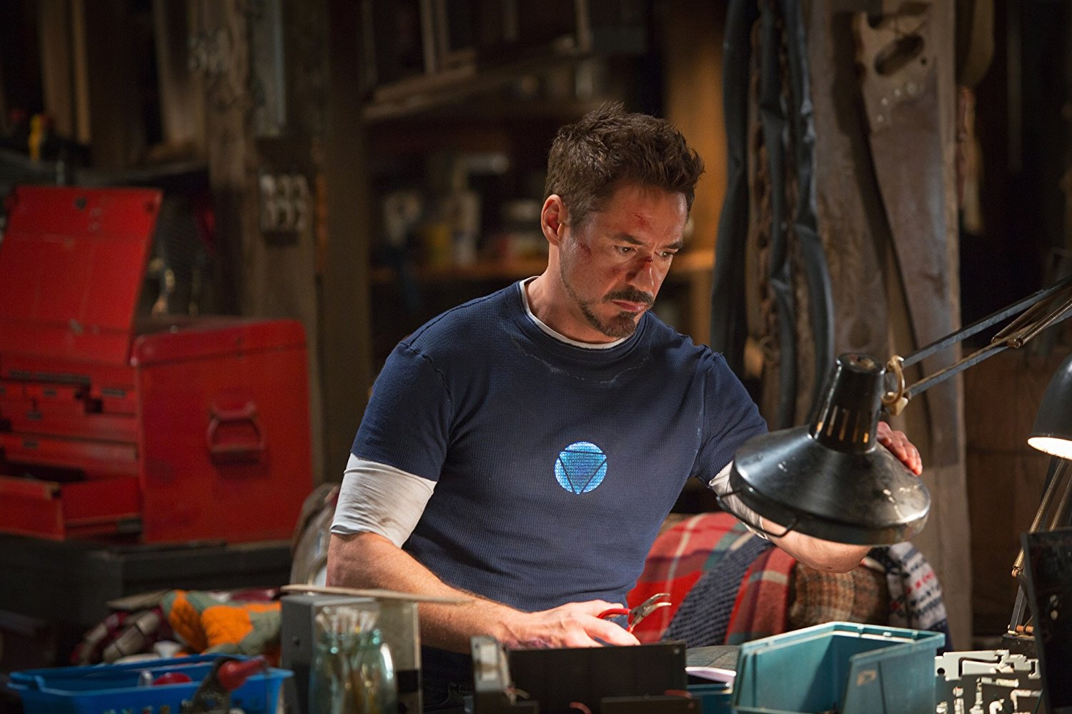 Tony Stark working on his suit in Iron Man 3