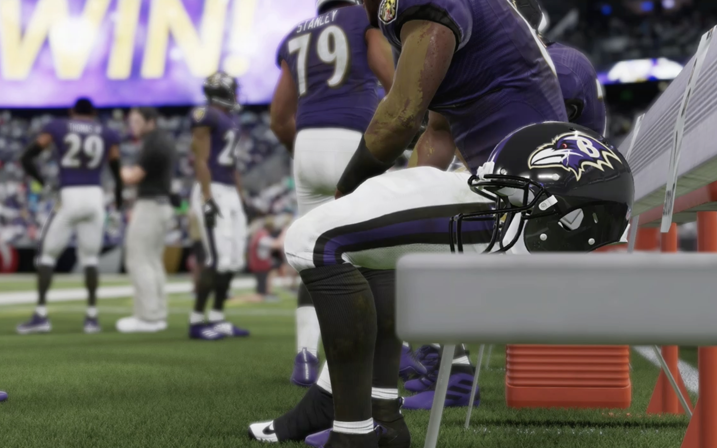 Ravens helmet on the bench with Ravens players in Madden 21
