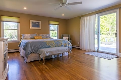 Master Bedroom With Sliders to Deck