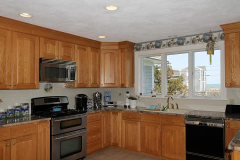 Super Country Style Kitchen With Tile Floor Open to Both Dining Room and Casual Dining Area. Did I Say With Views?