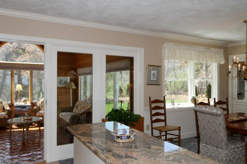 Dining Room Offers Built in China Cabinet and Built in Buffet With Granite Top and a Pretty Bay Window.