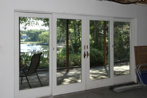 Lower Level is Waiting for Your Vision. Wall of Windows and Access to the Gardens and Path to Your Private Dock
