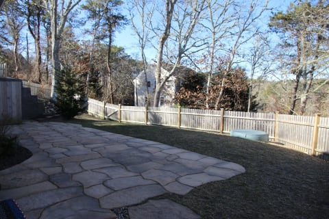 Fenced in Backyard With Stone Patio