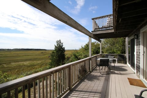 Right Side of the First Floor Deck Facing the Marsh With Bay Views.