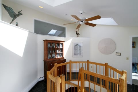 Landing With Skylights and Vaulted Ceilings. Access to Either Bedroom Upstairs.