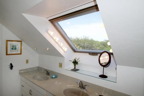 Light Infused Bathroom With Tub and Shower.