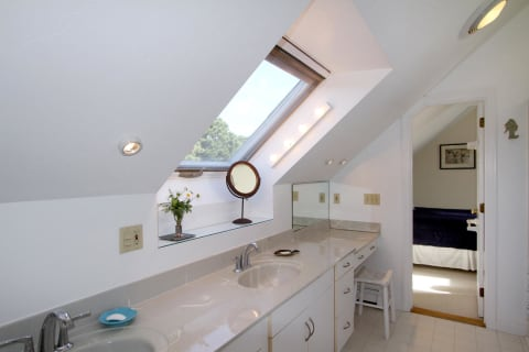 Bathroom With Skylight and Vanity for Primping.