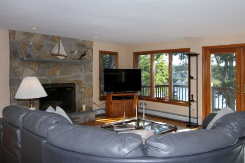 Great Room is Anchored by a Wood Burning Stone Fireplace