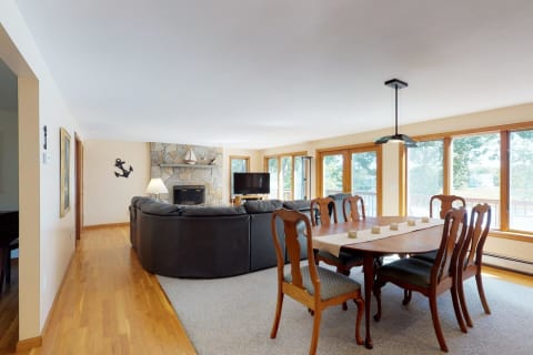 Great Room Features a Wall of Windows and Gleaming Hardwood Floors