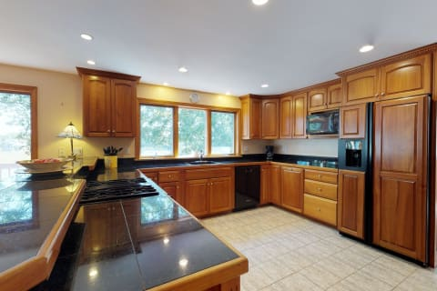 Gorgeous Cherry Kitchen With Black Appliances