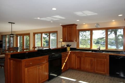 Spacious Kitchen With Great Counter Space Bar Seating and Views
