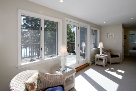 Sunny Second Floor Landing Opens to Deck. Your Guests Will Enjoy This Spot!
