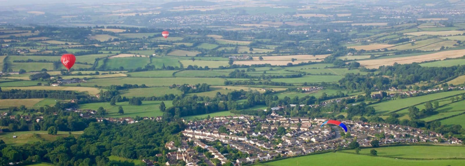 Paramotoring past the Virgin Hot Air Balloon near Bristol