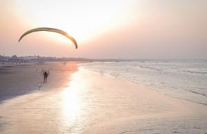 Paramotor foot drag on the beach at sunset in Oman