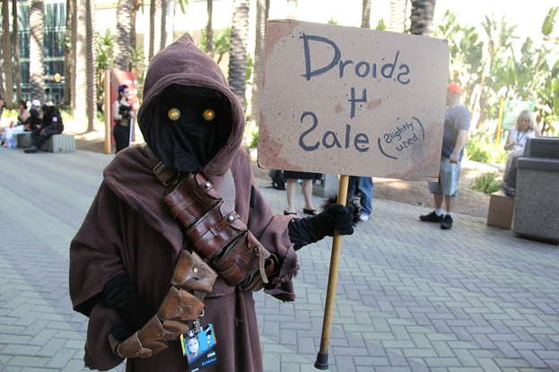 21. Uncle Owen purchases a droid because he needs help with what language?
