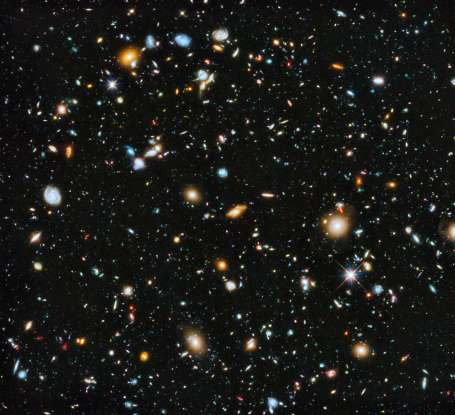 9. How old is the universe in years?