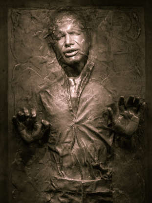 9. Who releases Han Solo from his carbonite freeze?
