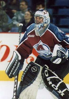 5. Which goalie holds the record for the most playoff wins?