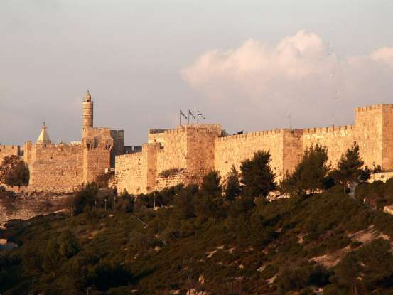 16. Who begins to rebuild the walls of Jerusalem after the first Temple is destroyed?