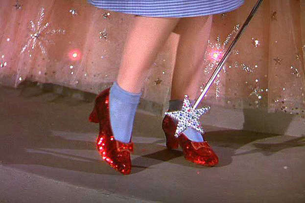 1. Dorothy taps her shoes how many times to do what?