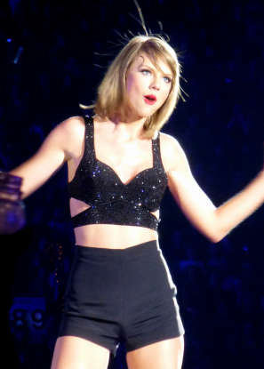 2. What genre did Taylor Swift first begin her career in?