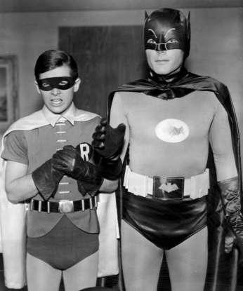 9. Which 60s show features two crime-fighting superheroes defending Gotham?