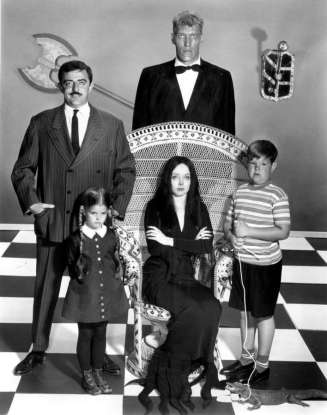 10. Which 60s show ran at the same time as <em>The Munsters</em> and has a similar theme?