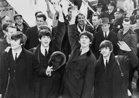 8. Which black-and-white 1960s comedy follows the Beatles in a fake documentary style?