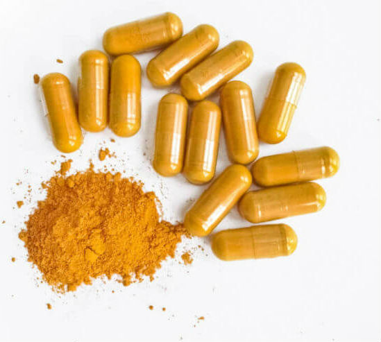 Capsules filled with turmeric