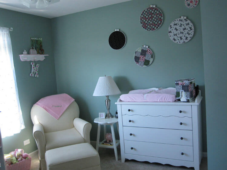 White and pink nursery with rocking chair and changing table