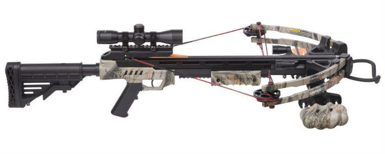 A camouflage colored crossbow with a scope