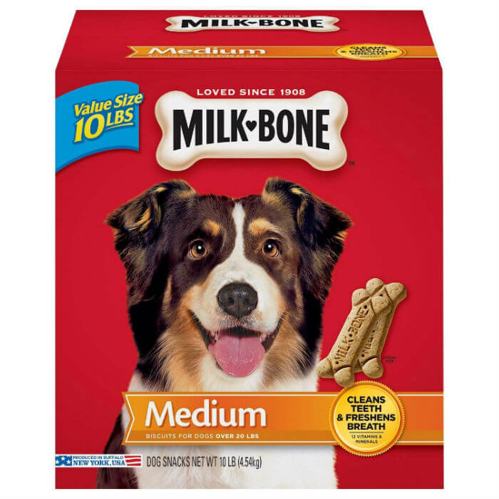 A red box of milkbone dog treats with smiling dog on the front