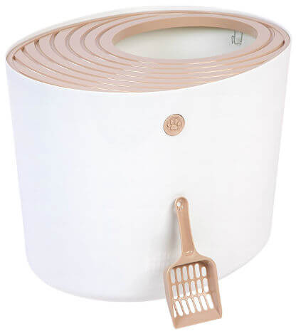 A white and pinkish beige litter box with opening at the top sits beside a matching litter scoop