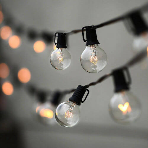 Round light bulbs hang from a string