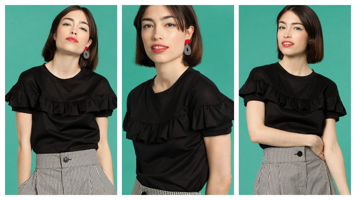 Opt for European casual chic style with this lovely and feminine black ruffle t-shirt.