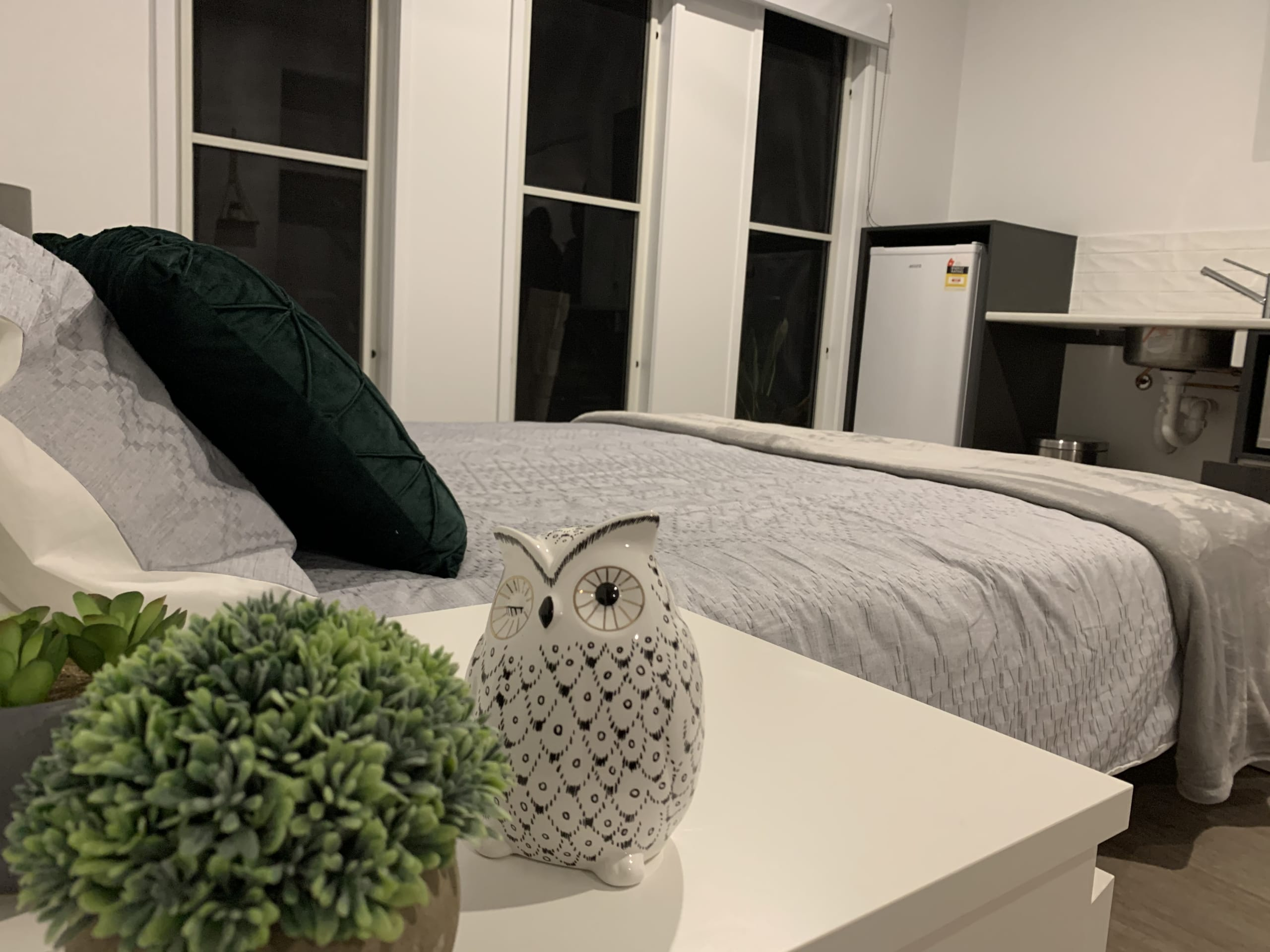 Image of bedroom featuring kitchenette