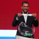 DOHA, QATAR - APRIL 27: Younis Mahmoud of Iraq holds out the name for Iraq as he helps with the draw during the FIFA Arab Cup Qatar 2021 Official Draw at Katara Opera House on April 27, 2021 in Doha, Qatar. (Photo by Mohamed Farag - FIFA/FIFA via Getty Images)